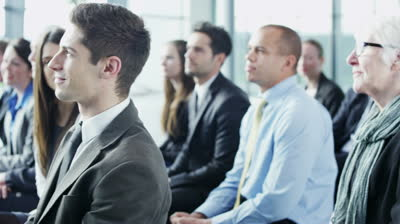 Stock-footage-a-diverse-group-of-business-people-of-mixed-ages-are-listening-to-a-presentation-at-a-business